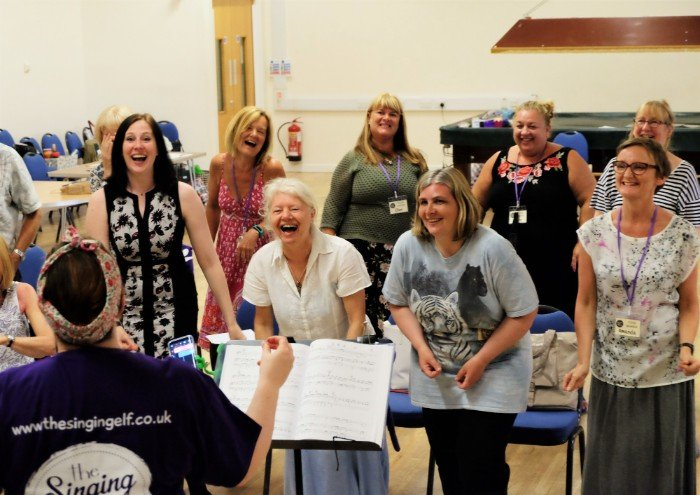 Unity Choir Laughing Rehearsal Singing Elf
