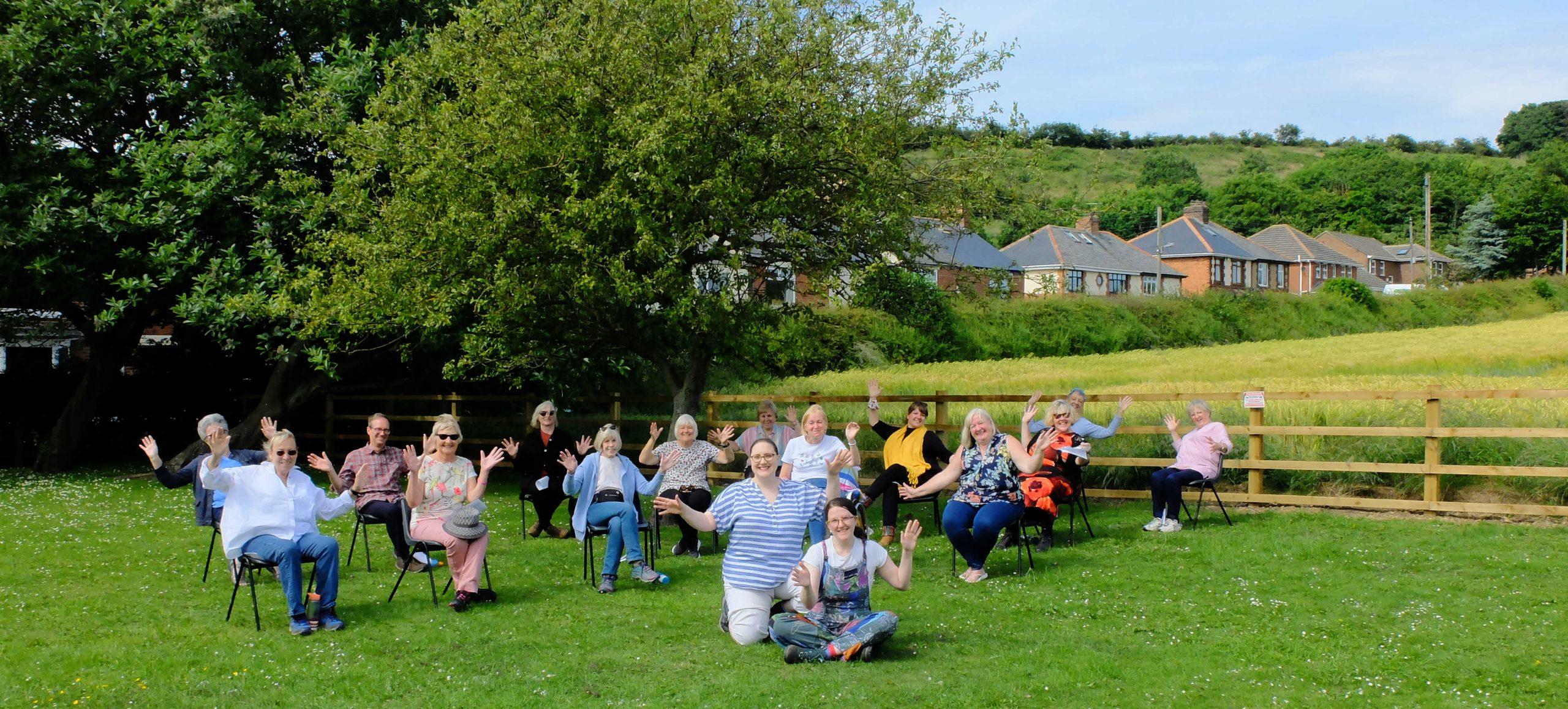 Unity singing outdoors at Pittington Picnic
